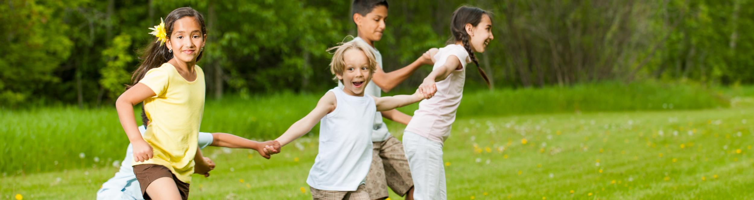 children running holding hands