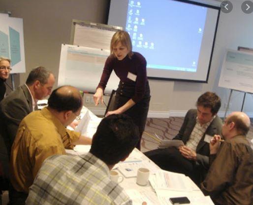 Sarah Lusina facilitates a collaborative scientific meeting